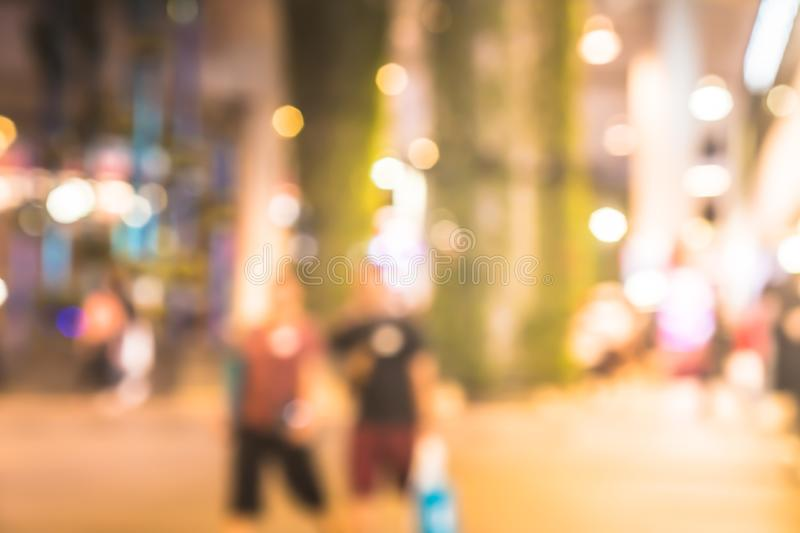 Blur people walking and shopping at shopping center in town stock image
