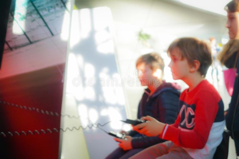 Blur picture of children playing game with remote device stock images