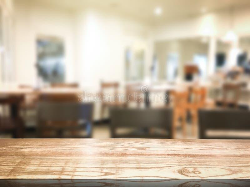 Blur restaurant or desserts cafe interior store background. Wooden shelf backdrops for design. Shelf stock photo