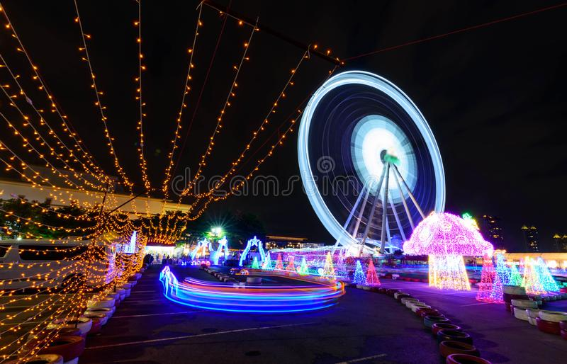 Blur rotate moving of Ferris wheel with lighting. At carnival park in night time stock image