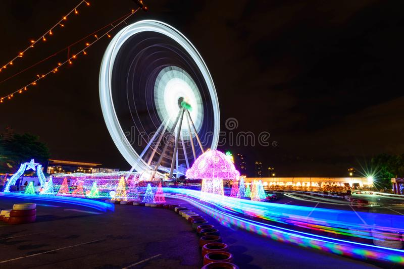 Blur rotate moving of Ferris wheel with lighting. At carnival park in night time royalty free stock image