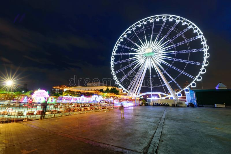 Blur rotate moving of Ferris wheel with lighting. At carnival park in night time royalty free stock images