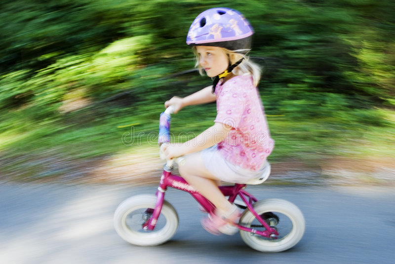 Download Blur Of Small Child On Bike Stock Photo - Image: 6606360