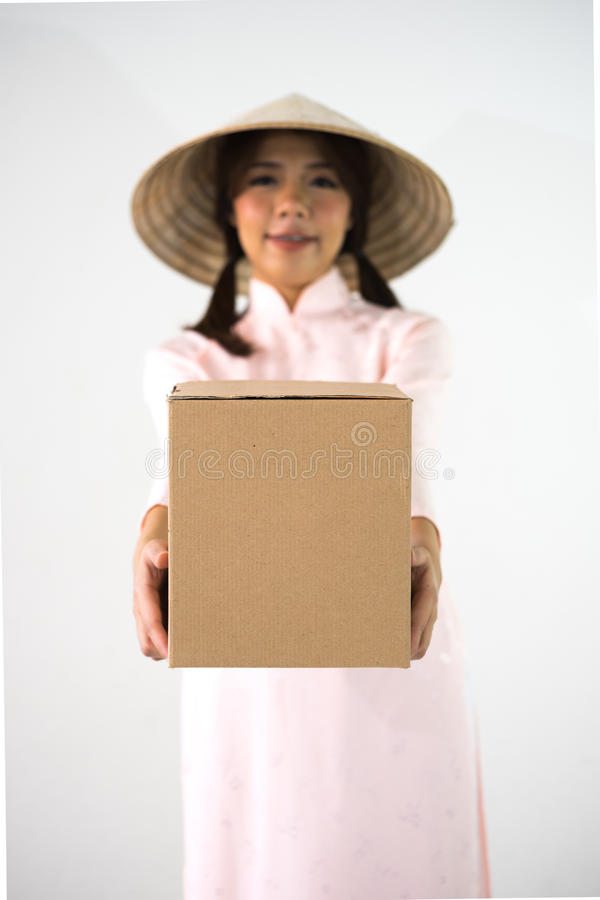 Blur smiling woman beautiful pink dress hands holding brown box royalty free stock photos