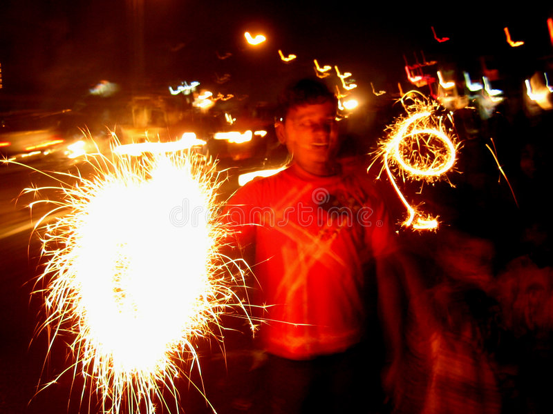 Blur Sparklers. A beautiful picture of street children in India with sparklers in Diwali festival stock photography