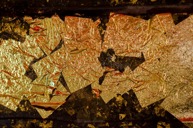 Blur Texture of the gold leaf, Gold background, Picture from Buddha image Back, gold leaf background stock photos