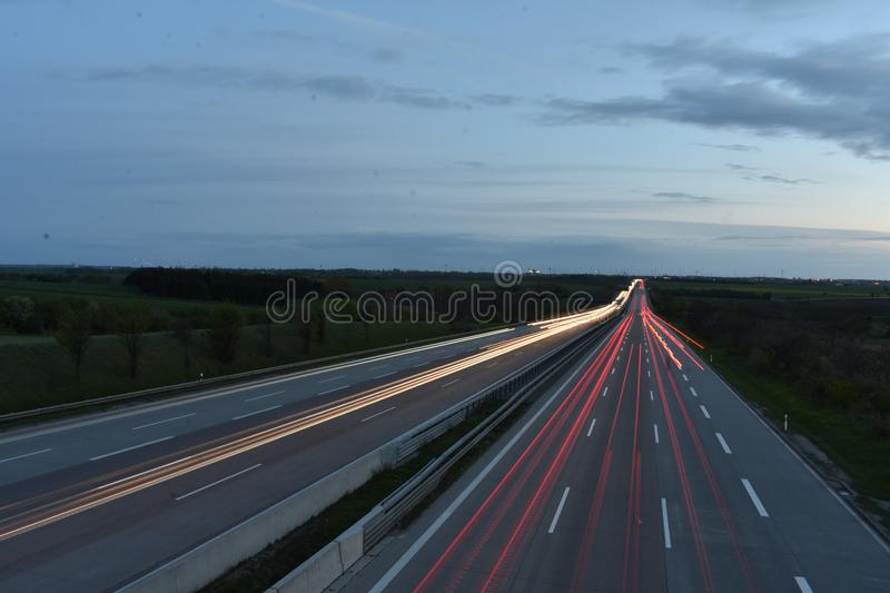 Blur of traffic lights on highway royalty free stock photography