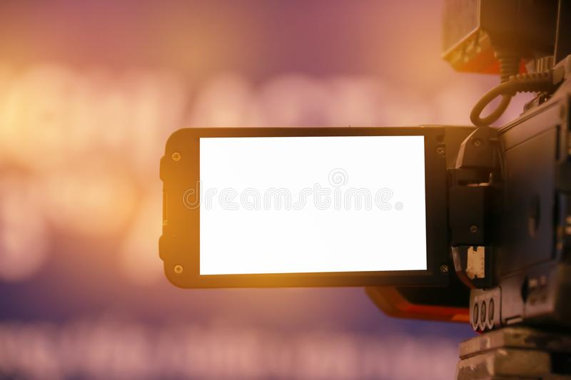 Blur of Video camera or camcorder operator working for record co. Uple speaker or Presenterson stage in conference and convention hall in Vietnam, blak white royalty free stock image