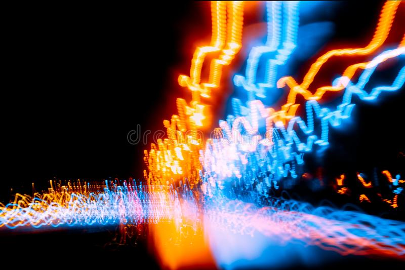 Blur wave light trial motion night road driving fast. Speed abstract effect for background stock image