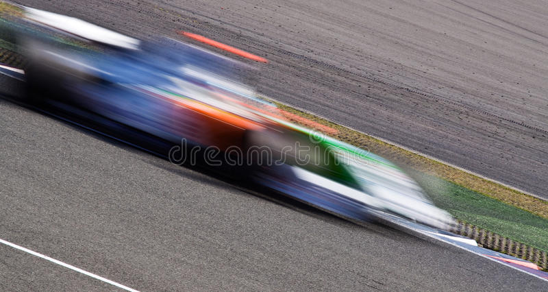 blurbilen fast racen arkivfoto
