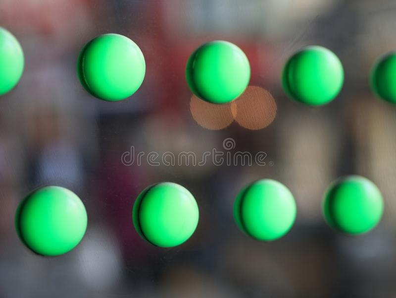 Blurred green circles on a shinny sliver surface. Abstract background. Blurred green balls on a shinny sliver surface. Abstract colorful background royalty free stock photos
