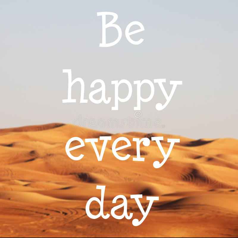 Blured desert with text: Be happy every day royalty free stock photography