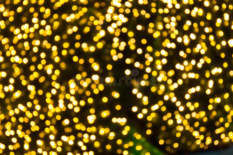 Blured gold color bokeh christmas background stock photo