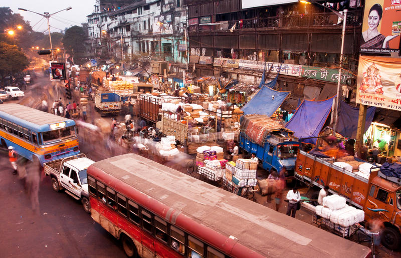 Blured in motion busy street with cars and buses stock photography
