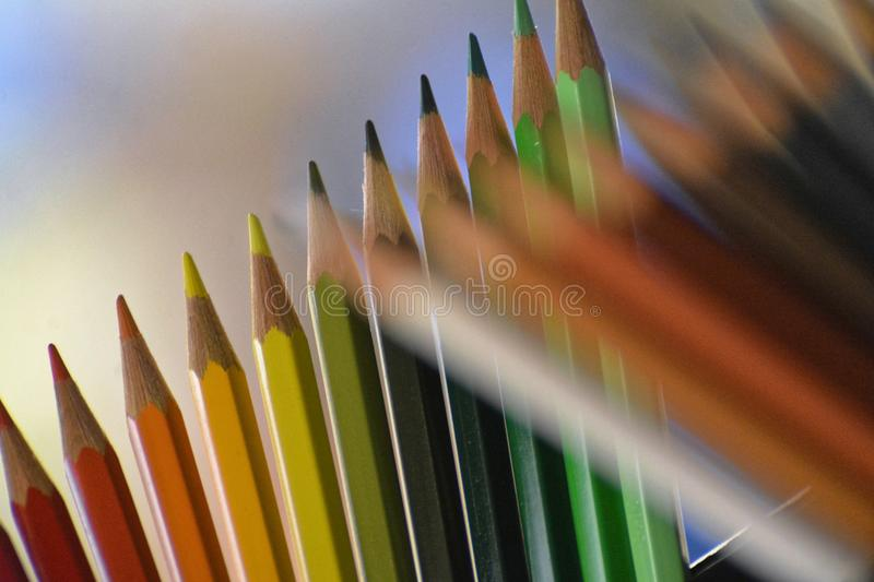 Blured and sharp multicolor pencils royalty free stock photography