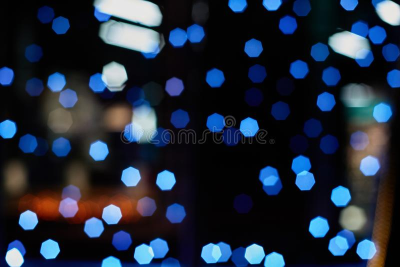 Blured sparkle background. Closeup of blurred dark christmas background with sparkle lights royalty free stock images