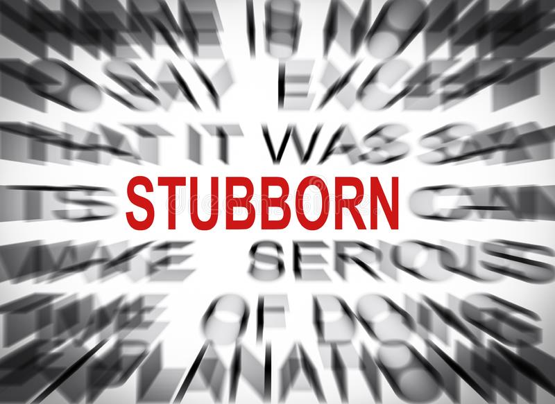 Blured text with focus on STUBBORN stock photography