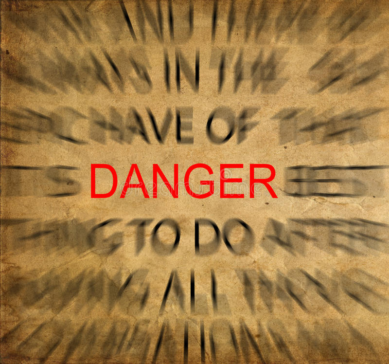 Blured text on vintage paper with focus on DANGER stock images
