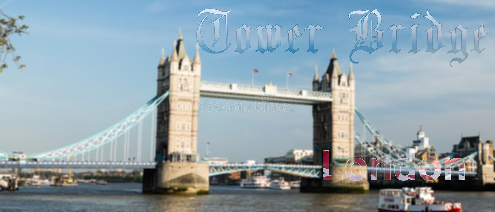 Blured Tower Bridge London with Old Gothic Text royalty free stock photo