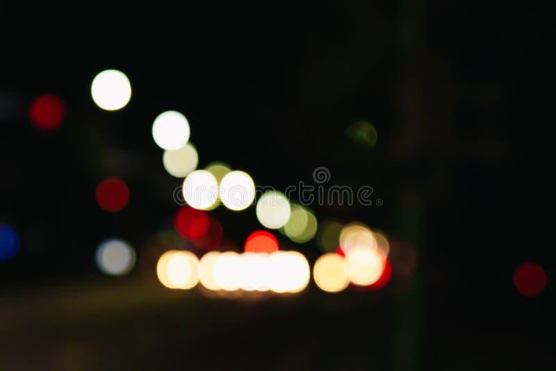 Blurende Weihnachtslichter auf schwarzem Hintergrund, Buch Lichtbogenabstraktion Das Konzept des neuen Jahres 2018, Urlaub, Urlau lizenzfreie stockbilder