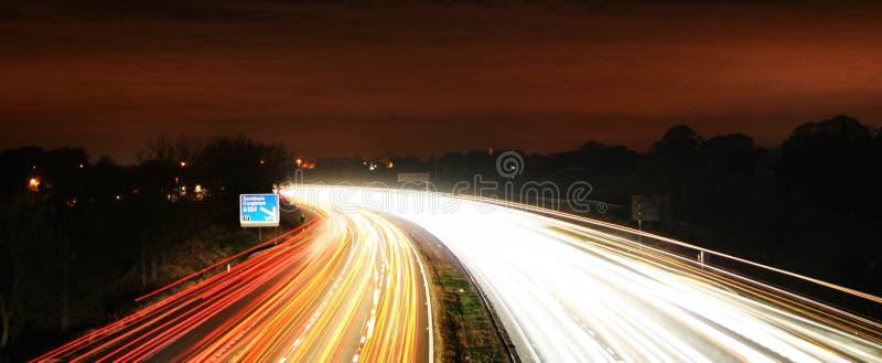 Blurr occupato di movimento di traffico di tempo del tnight fotografia stock