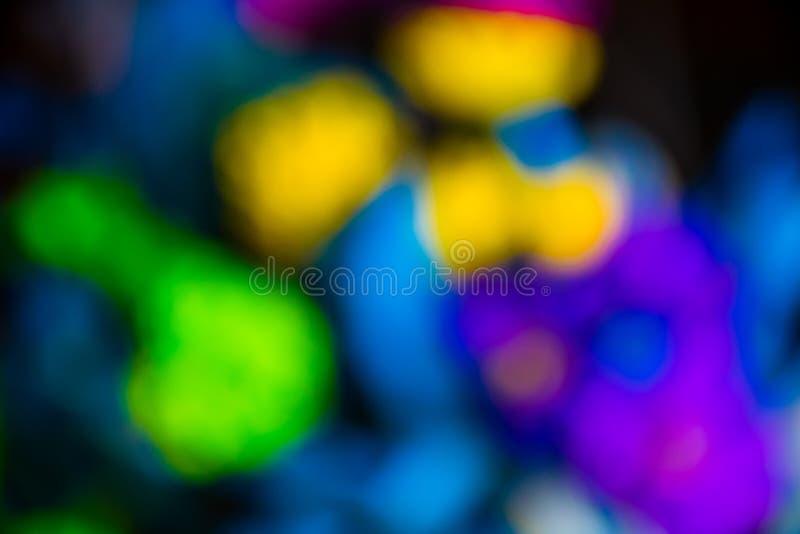Blurred花的抽象萤光明亮的颜色 免版税库存照片