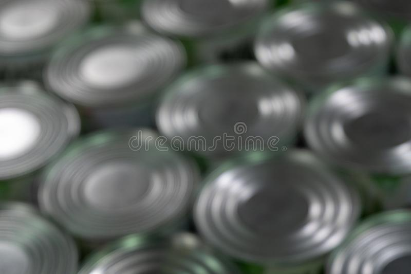 Blurred. Abstract background of cans. Round caps royalty free stock photos