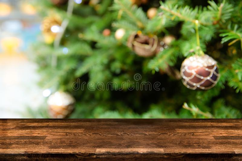 Blurred abstract of Christmas tree decorated with bauble balls hanging, light and small gift box. Can be used for backgound. Xmas royalty free stock photos