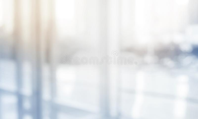 Blurred abstract grey glass wall building background. stock photos