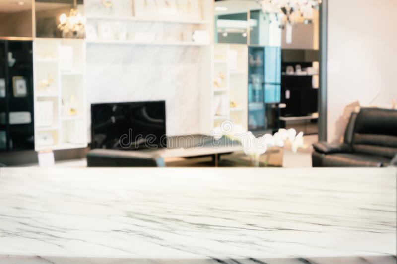 Blurred abstract of modern living room with marble shelf and TV. Empty marble table with Blurred abstract of modern living room with marble shelf and TV stock images