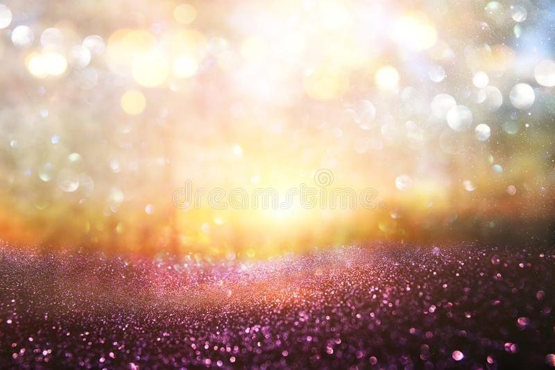 blurred abstract photo of light burst among trees and glitter golden bokeh lights. royalty free stock images