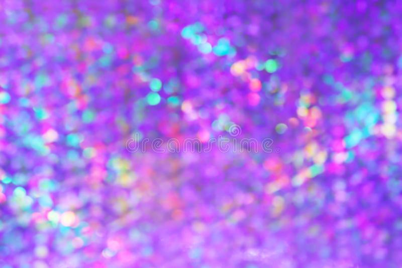 Blurred abstract violet purple bokeh light luxury background, gradient purple bokeh light glitter and shine background. The blurred abstract violet purple bokeh stock photo