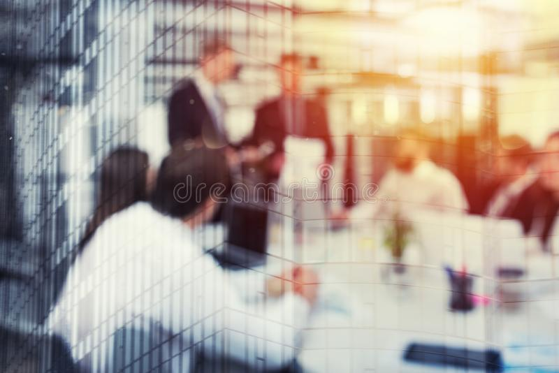 Blurred background of business people in office with futuristic effect. Blurred background with futuristic effect of business people during a meeting. double royalty free stock images