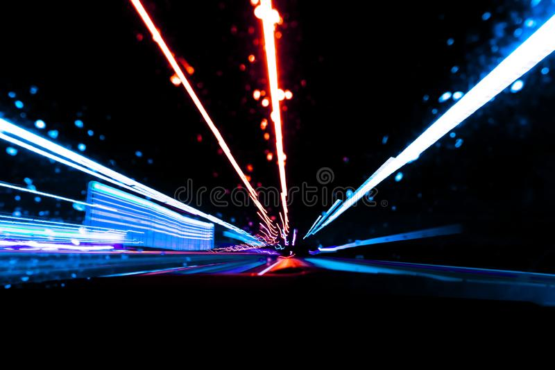 Blurred background with Cars light trails on a curved highway at night. Night traffic trails. Motion blur. Night road with traffic. Blurred background with Cars stock photo