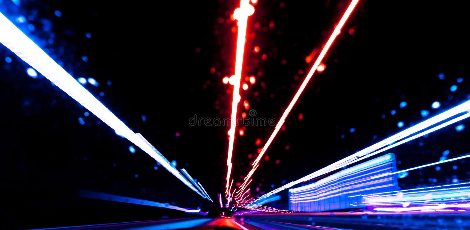 Blurred background with Cars light trails on a curved highway at night. Night traffic trails. Motion blur. Night city road with tr. Affic headlight motion royalty free stock photos