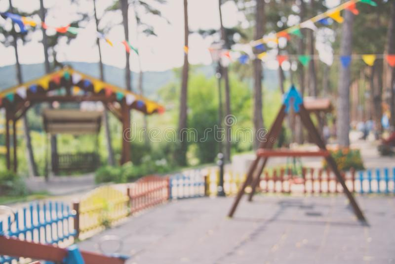 Blurred background of children playground with hanged over party banners. stock photos