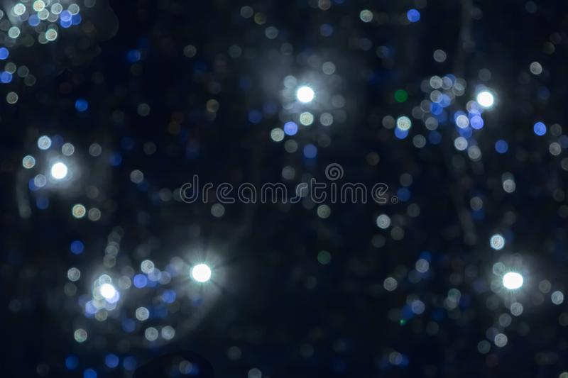 Blurred background of Christmas lights and Christmas tree lights, beautiful bokeh stock images
