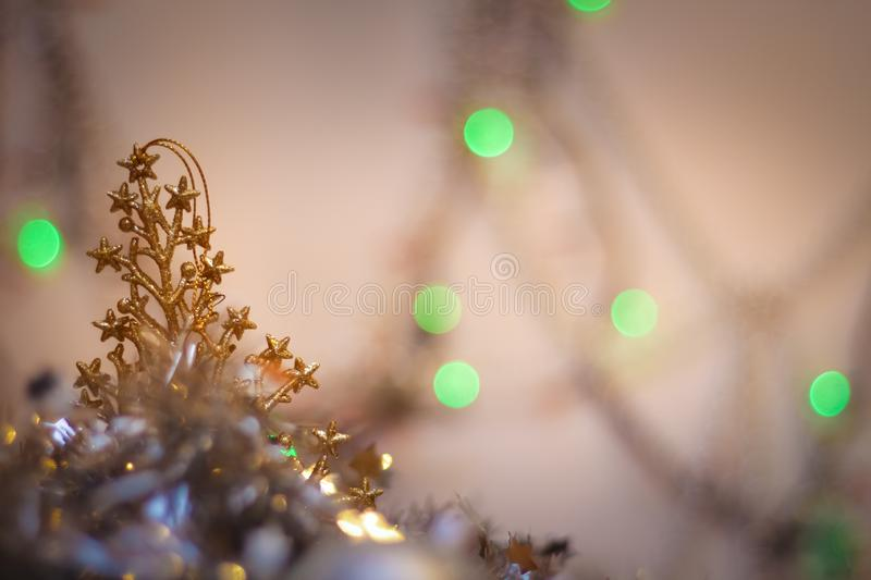 Blurred background of green lights. tree golden plastic silver garland postcard background Happy New Year stock photos