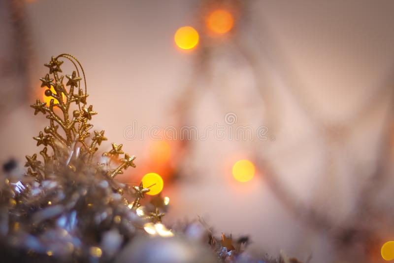 Blurred background of green lights. tree golden plastic silver garland postcard background Happy New Year royalty free stock photo