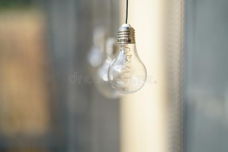Blurred background with a light bulb. Blurred background with a light bulb that charges from the sun royalty free stock photo