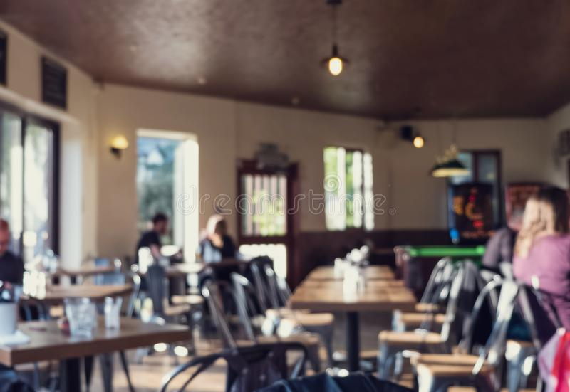 Blurred background of modern pub or cafeteria. stock image
