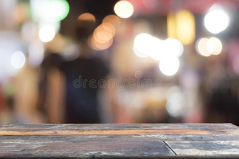 Blurred background and old wooden table on font. Abstract royalty free stock images