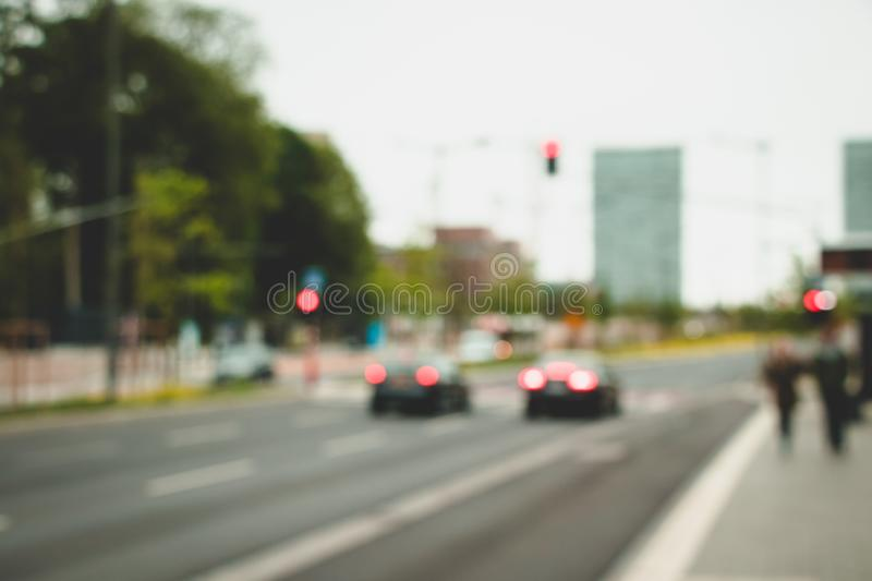Blurred background. Road, cars, lights and building. Background for your design. City concept royalty free stock photography