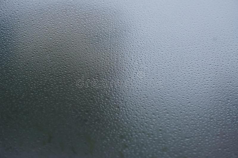 Blurred background when see through car windshield with full droplets stock photo