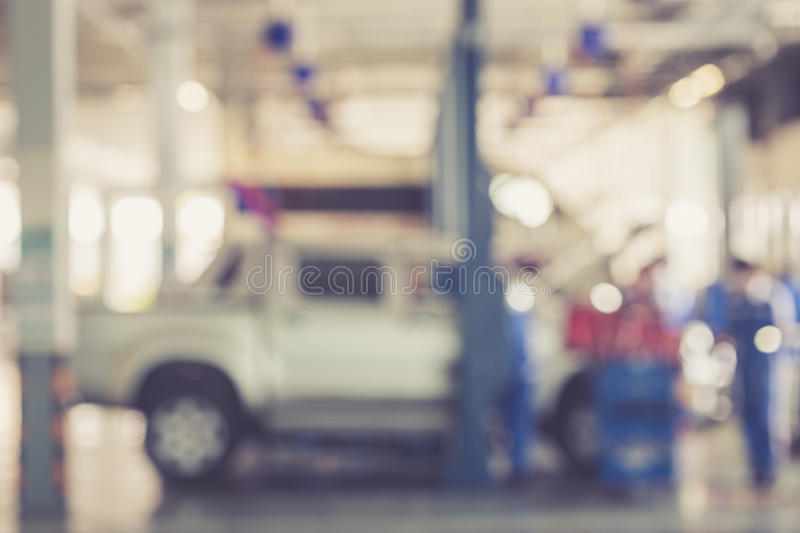 Blurred background : Thai people repairing the car in garage. Vintage color royalty free stock images