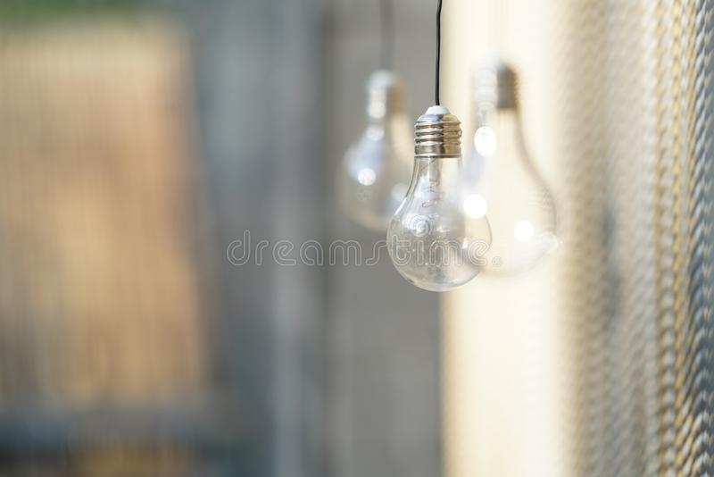 Blurred background with three light bulbs. Blurred background with three light bulbs which charges from the sun stock photography
