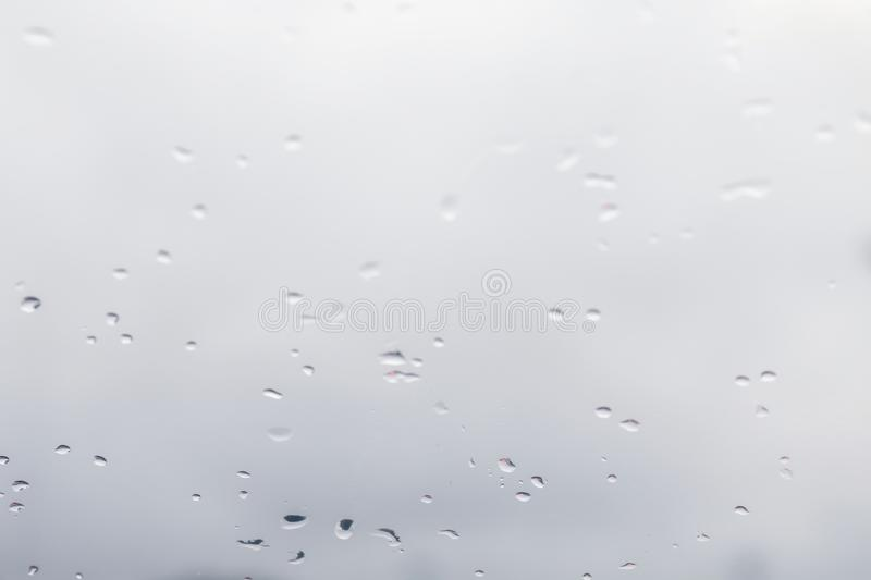 Blurred background water rain drops on glass windows, White Background rain cold royalty free stock images