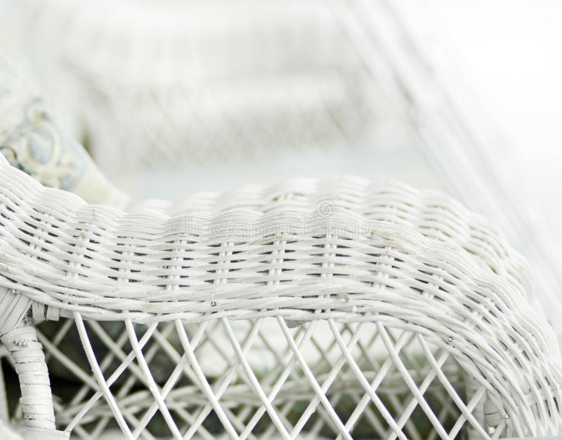 Blurred background white nostalgic vintage wicker chair royalty free stock photos