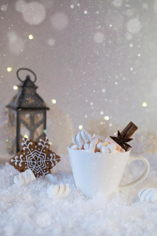 Blurred background of winter frost and Christmas chocolate spice beverage royalty free stock photo