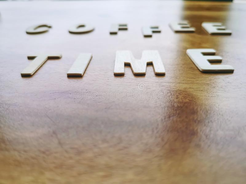 Wooden Alphabets Coffee Time Word with Selective Focus. Blurred Background of Wooden Alphabets Coffee Time Word with Selective Focus stock photography